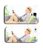 Senior man sending an sms via cell phone at home cell phone cover case iPhone 4 5 6 / iPad mini 2 3 / Samsung S3 S4 S5 S6 Note2 Note3 Note4 / HTC Blackberry Sony Huawei